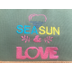 """Pochette en coton et base en toile de jute brodée """"sea sun & love"""""""